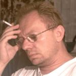 male head glasses, smoking, eyes shut